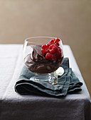 Chocolate mousse with berries in a glass