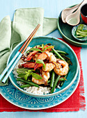 Hot and sweet prawns with stir-fried greens