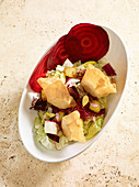 Goat's cheese in filo pastry on a mixed salad