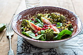 Salad with roasted romanesco, spinach, figs and pomegranate seeds