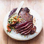 Grilled flank steak with parsley and tomato salsa