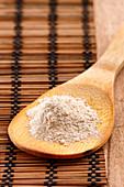 Tsampa flour on a wooden spoon (Tibet)
