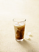 Iced tea macchiato with coconut and lemongrass