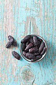 Tonka beans in a small bowl