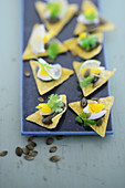 Tortilla chips with pumpkin seed paste