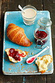 Croissant with jam and white coffee