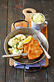 Turkey schnitzel with cauliflower and coleslaw