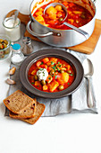 Pork goulash with potatoes, pepper and olives