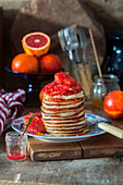 A stack of pancakes with blood oranges