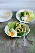 A salad with poached quail's eggs and roasted onions