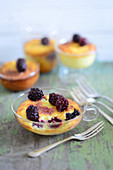 Blackberry and cheese cakes in a glass cup