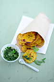 Plantain chips with green mojo sauce