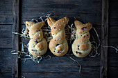 Sweet vegan yeast buns shaped like bunnies with sugar nibs