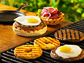 Burger with fried egg and pineapple