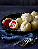 Fruity potato dumplings with a strawberry filling