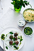 Lamb meatballs on yoghurt and peppermint sauce with mint pesto and couscous