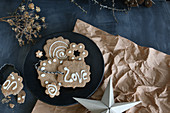 Gluten-free shortbread biscuits decorated with icing and the word 'Love'