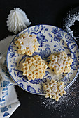 Gluten-free snowflake biscuits with icing sugar for Christmas