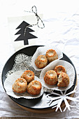 Mini muffins on a lace doily with a cut-out Christmas tree