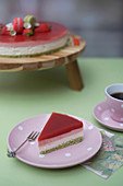 A slice of lemon and strawberry mousse cake
