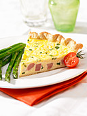 Slice of ham quiche with chive
