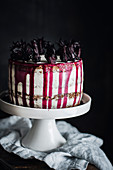 Hibiscus and mascarpone layer cake on a cake stand
