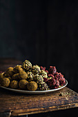 Homemade sea buckthorn, pistachio and cherry truffles