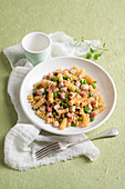 Fusilli with ham, chicken and peas