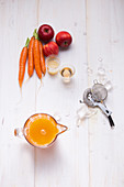 Ingredients for a Revitalizer with carrots, apple and ginger