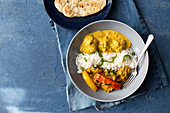 Chicken jalfrezi and chicken korma with rice and naan bread (India)
