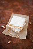 Halva with almond and rice paper (Israeli sweets)