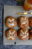 Hand made hot cross buns with a twist, with a decorative angry face