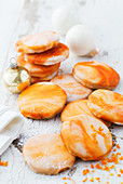 Orange biscuits with marbled orange icing