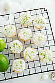 Lime and coconut shortbread biscuits on a cooling rack