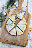 Lemon and ginger shortbread on baking parchment