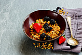 Granola muesli with blackberries and strawberries
