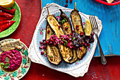 Roasted aubergines with a beetroot hummus, pomegranate and spearmint