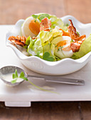 Lettuce with eggs and crispy bacon