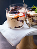 Gingerbread mousse with prunes and punch sauce