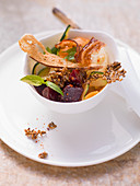 Vegetable salad with sesame brittle, bacon and pretzel chips