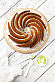 Overhead Courgette Lime Bundt Cake with Drizzled Icing Lime Zest