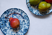 Red pear on a blue plate