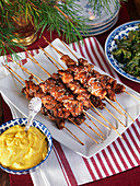 Chicken skewers, saffron yogurt and kale
