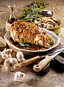 Leg of lamb with garlic, sage and mushrooms