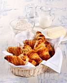 Fresh croissants in a bread basket