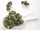 Kale chips on a white plate