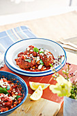 Lamb koftas with chickpeas and spicy tomato sauce