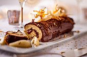 Yule log with pears and caramel for Christmas