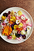 Edible flowers on a plate seen from above