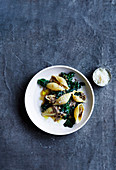 Conchiglione with ragu bianco, anchovies and wilted kale